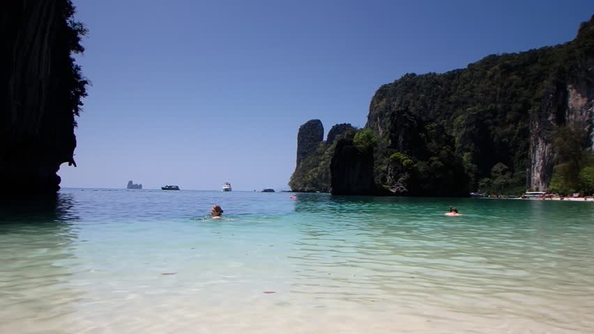 Sandy beaches of Thailand. People relaxing on the Beach. Full HD footage. Andaman sea beaches full of People.