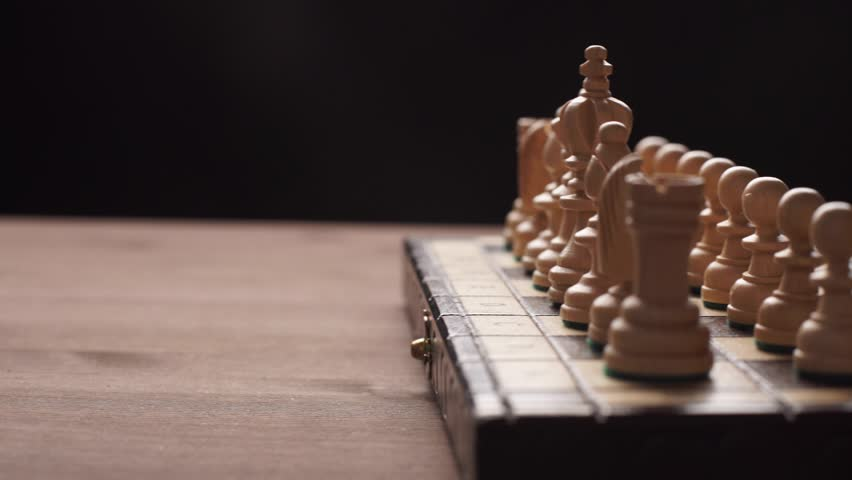 Man playing wooden chess pieces | Shutterstock HD Video #15173998