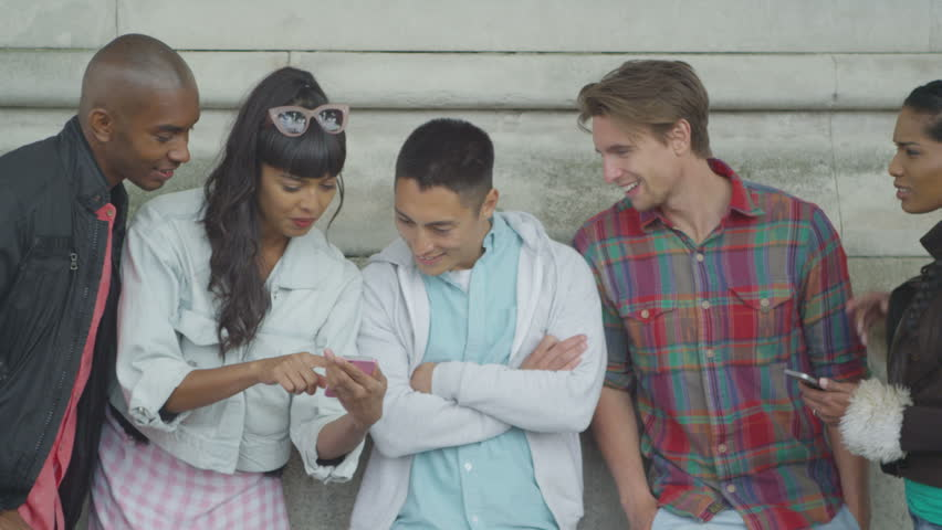 4K Portrait of happy mixed ethnicity group of friends looking at smartphone outdoors   Shutterstock HD Video #15184168