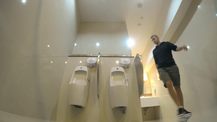 Male peeing male urinal