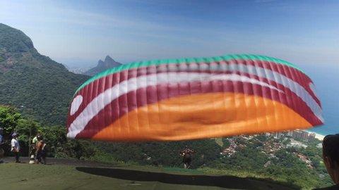 Paragliding take off from the mountain in Rio De Janeiro, Brazil.