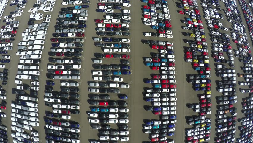 Aerial top down bird view of new car storage parking lot showing imported new vehicles or ready to export new automobiles storage facility car industry for American and European market for car sales | Shutterstock HD Video #15207190
