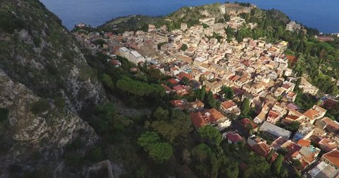 Aerial shot of the Taormina, ancient buildings and an amphitheater on the east coast of the island of Sicily, Italy