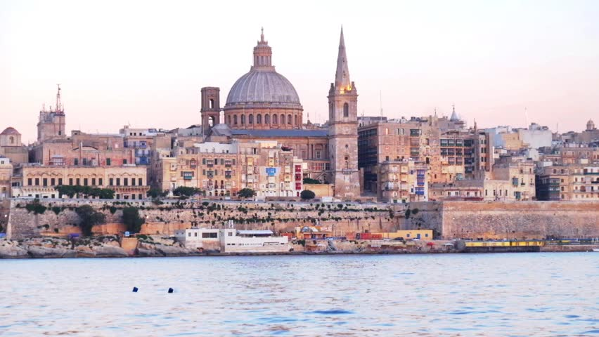 View on Valletta St. Paul's Anglican Cathedral and belltower of Charmelite Church from Sliema embankment at the Evening time, Malta