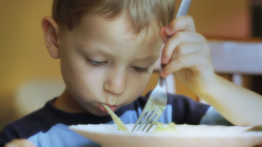 Little boy eating spaghetti. Small depth of field. Close up. Canon 7d, HD 1080 25p