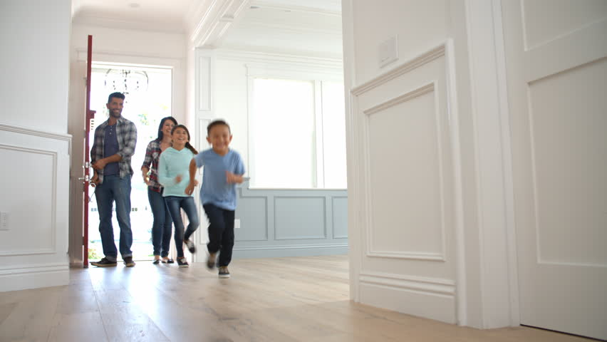 Slow Motion Shot Of Hispanic Family Moving Into New Home  | Shutterstock HD Video #15281578