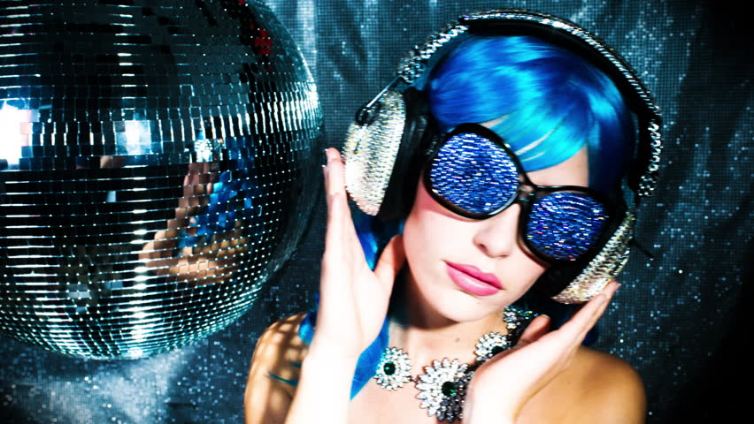4k stunning sexy disco woman with bling crystal covered headphones surrounded by disco balls
