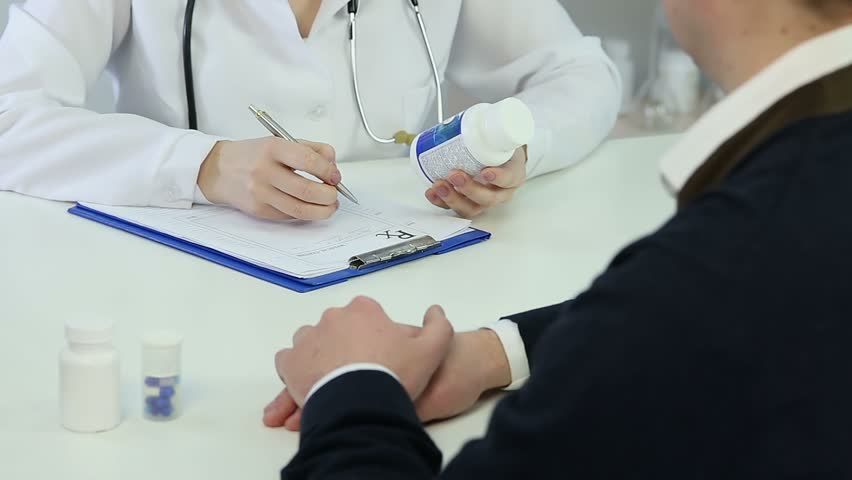 Female therapist prescribing drugs to patient, recommending pills for treatment | Shutterstock HD Video #15299968