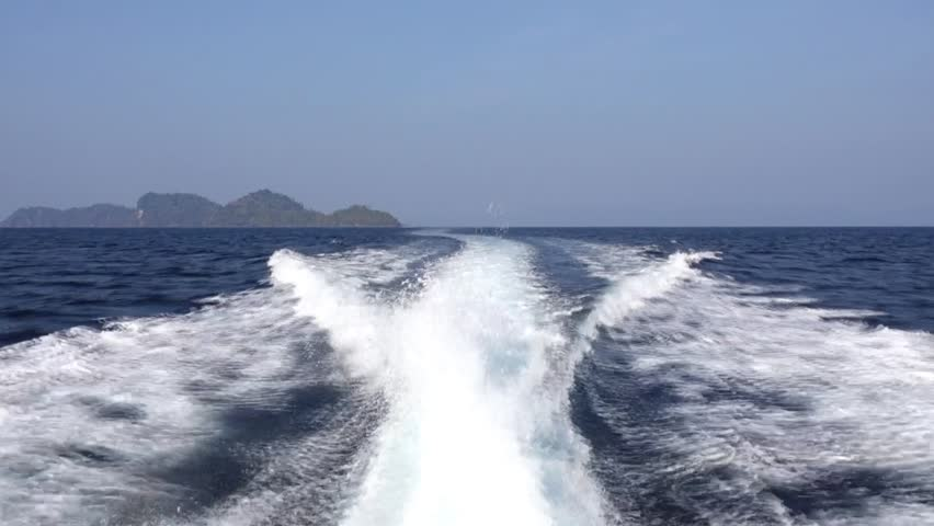 Water splash from high power speed boat during journey in Andaman sea Thailand