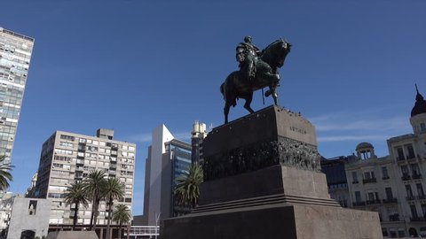 MONTEVIDEO, URUGUAY - FEBRUARY 11, 2016: Dolly shot to Artigas statue in Independence Square. Jose Gervasio Artigas is considered the father of Uruguay.