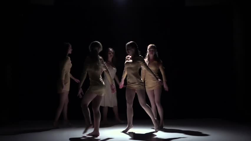 Contemporary dance of five talanted girls in white dresses, on black, shadow, slow motion