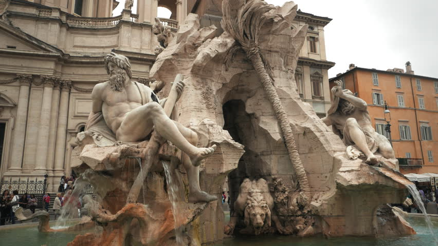 ROME, ITALY- SEPTEMBER 30, 2015: a walking 3 axis gimbal shot of the four rivers fountain in rome's piazza navona