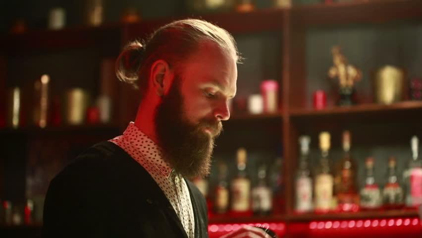 Handsome barman professional at posh bar making cocktail drinks #15359716