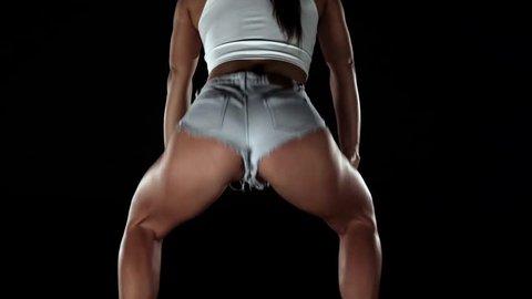 Girl in denim shorts dance twerk. Black. Slow motion