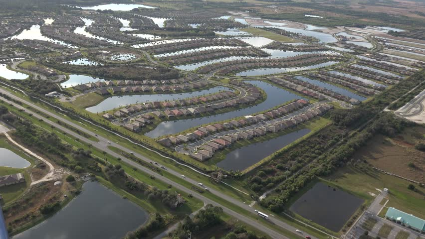 florida houses on the water. florida everglades drainage water condos filling in 4k stock video clip houses on the t