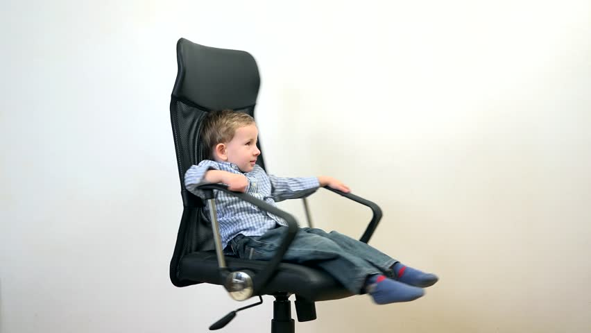 Fuuny Kid Spinning In An Office Chair Manager Has Fun At Work