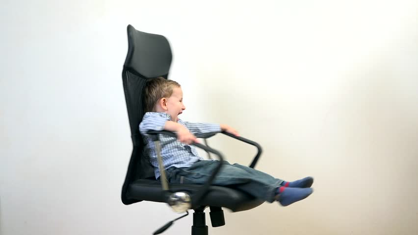 cute childs office chair. funny kid spinning in an office chair manager has fun at work 4k stock cute childs i