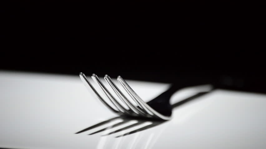 Fork Rotating On White Base With Black Background Hd Stock Footage Clip