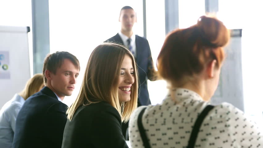 Smiling business people discussing on a meeting in conference room, graded | Shutterstock HD Video #15414868