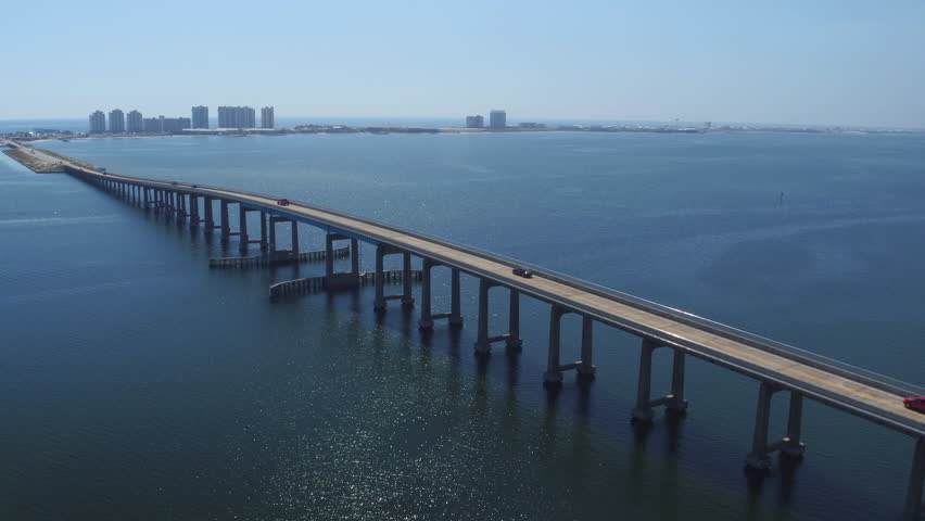 AERIAL: Long highway bridge viaduct across the ocean from mainland to big city Miami beach in sunny Florida | Shutterstock HD Video #15417058