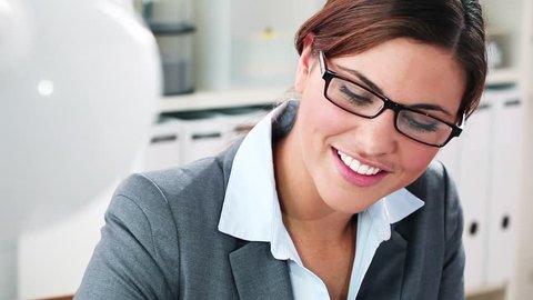 Sext secretary smiling at camera