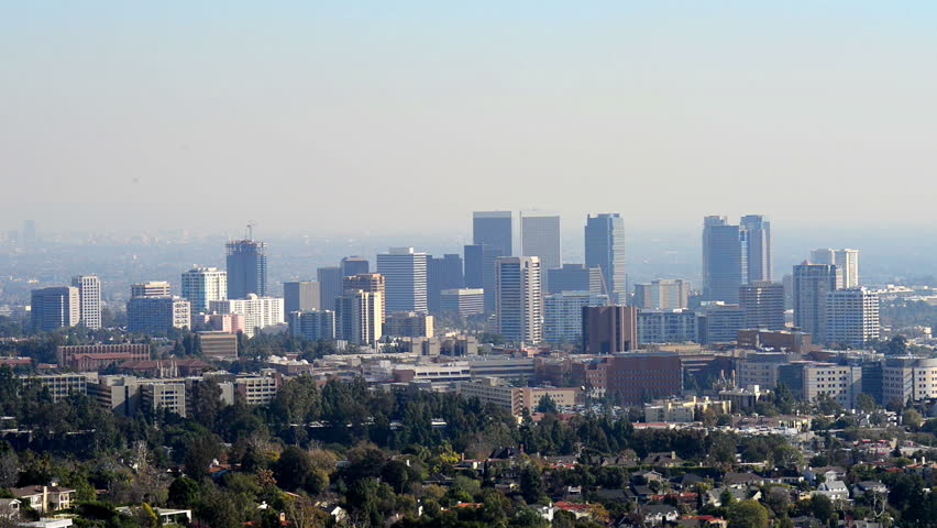 Downtown Los Angeles skyline over blue cloudy sky | Shutterstock HD Video #15422680