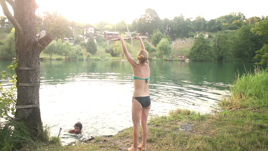 98ba9bee7763 Young Blonde Girl Jumping Off Stock Footage Video (100% Royalty ...