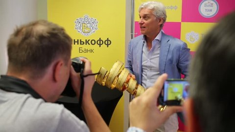 MOSCOW - JUN 03, 2015: Oleg Tinkoff holds Giro d Italia award. Tinkoff Saxo bank - sponsor of Spanish team won cycling in Giro d Italia 2015