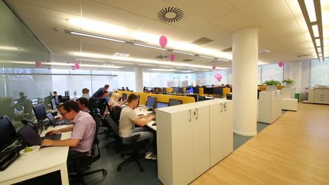 MOSCOW - JUN 03, 2015: People in office. Tinkoff Bank - only full online bank in Russia