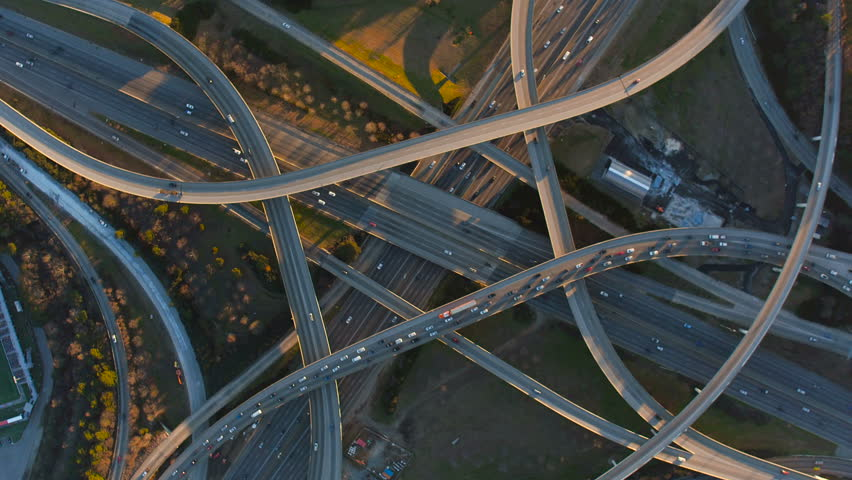 Atlanta Aerial v213 Flying vertical shot over Spaghetti Junction freeways panning at sunset.