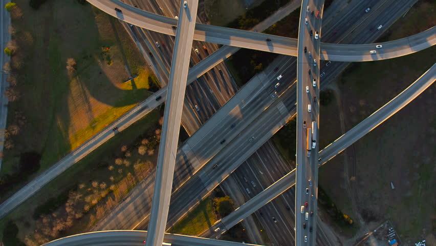Atlanta Aerial v212 Flying vertical shot over Spaghetti Junction freeways panning at sunset.