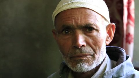 SRINAGAR, INDIA - JUNE 06, 2015: Portrait of an unknown Indian muslim man in the market. Kashmiris are fighting for their freedom for 20 years. Kashmir became dangerous again.