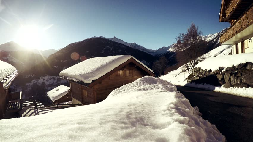 Chalets In Stunning Mountain Scenery. Snow covered chalets high in the beautiful Alps