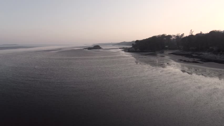 Aerial view of Scottish beach at low tide at dusk