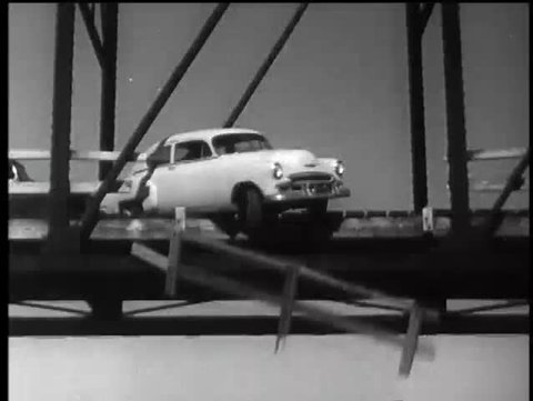 Car falling from bridge into river, 1960s