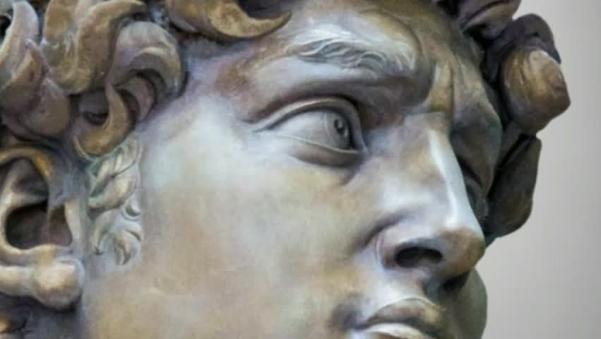 Detail close-up of Michelangelo's David statue with the effect of removing the object from the camcorder