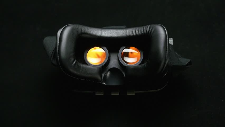 Male hand taking a virtual reality headset. Virtual reality mask.