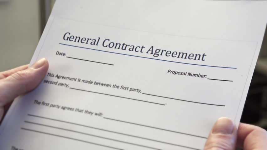 Residential Tenancy Agreement Form In Male Hands. Renting Is An