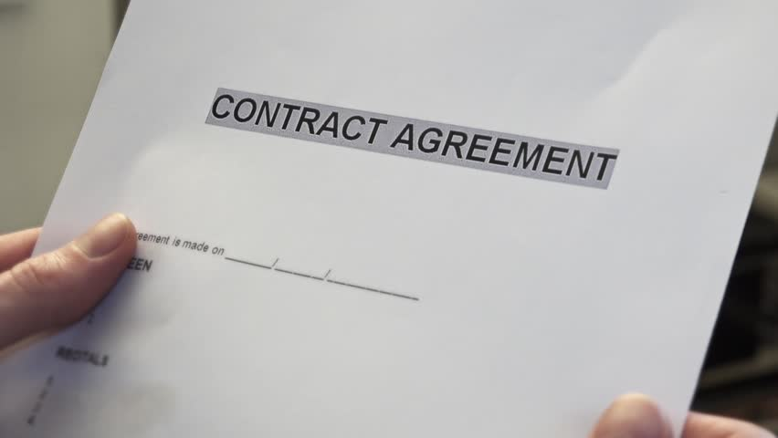 Man With A Blank Contract Agreement Form In Hands A Contract Is A – Blank Contract