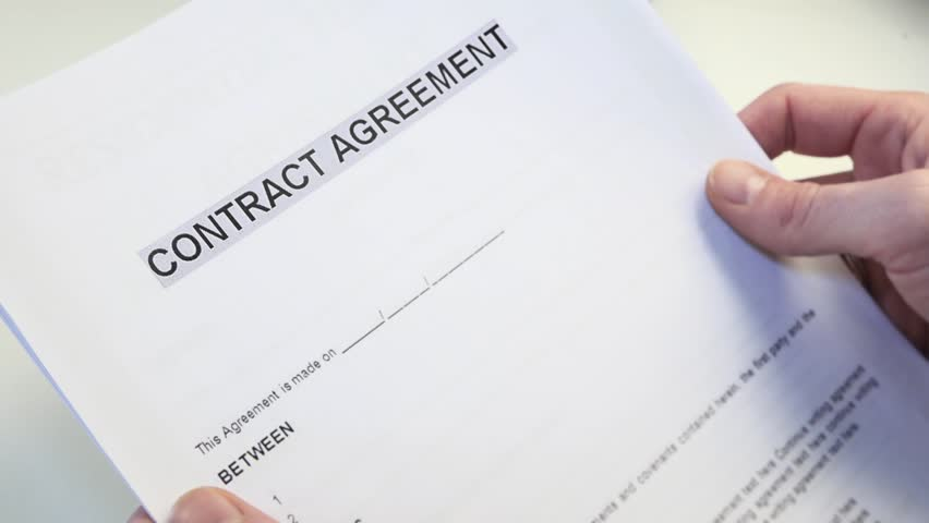 Man With A Blank Contract Agreement Form In Hands A Contract Is A – Blank Contract Forms