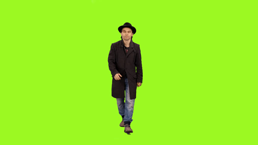 Front view of a man walking & smiling on a green screen background, Full HD shot with alpha channel