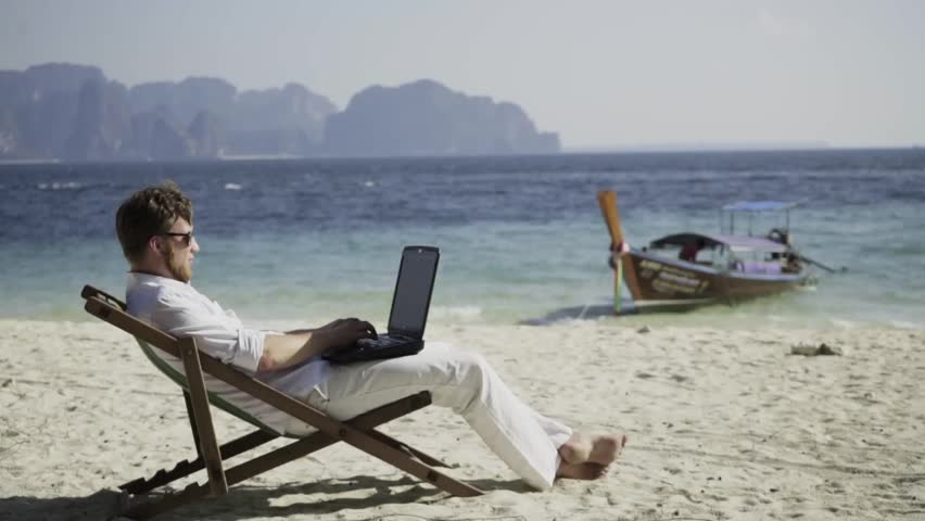 Dream work. Man works on the wonderful beach and enjoys his life. The happiest work. Freelance. | Shutterstock HD Video #15670147