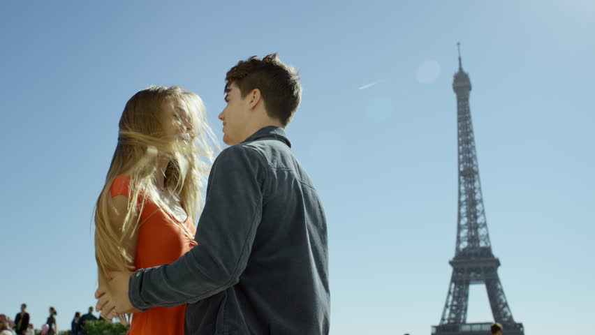 Young man proposes to his beautiful girlfriend with the Eiffel tower in the background. Paris, France | Shutterstock HD Video #15686668