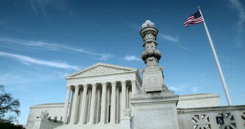 The US Supreme Court medium wide with flag and light pole. Also available in 4K SLog.