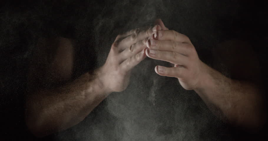 SLOW MOTION closeup of an athlete hands clapping with white chalk powder that explodes in slow motion particles of dust, take 2, multiple claps | Shutterstock HD Video #15696943
