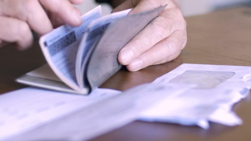 An aging senior balances his checkbook
