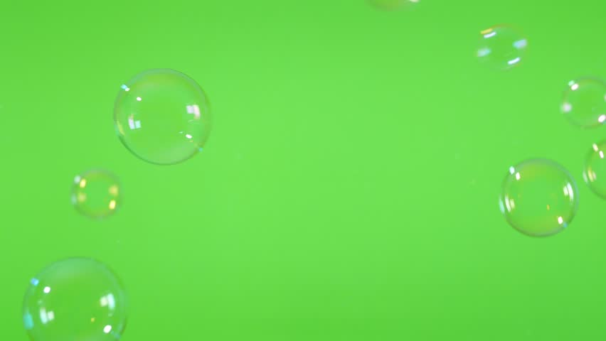 Green screen with soap bubbles flying and falling down 4K 2160p 30fps UltraHD video - Bubbles made of soap in front of greenscreen chroma key background 4K 3840X2160 UHD footage