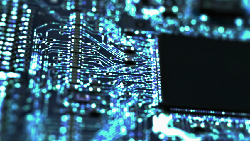 Circuit Board / Processor Chips / Data Streams. Macro tracking over circuit board with conceptual image of the blue electrical signals flowing in electrical conductors. (av27383c)