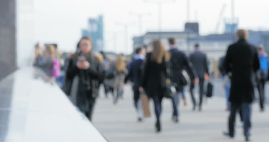 Defocussed London business commuters at rush hour. Abstractly stylised video footage of business and office workers during the rush hour commute in London's business district. | Shutterstock HD Video #15749644