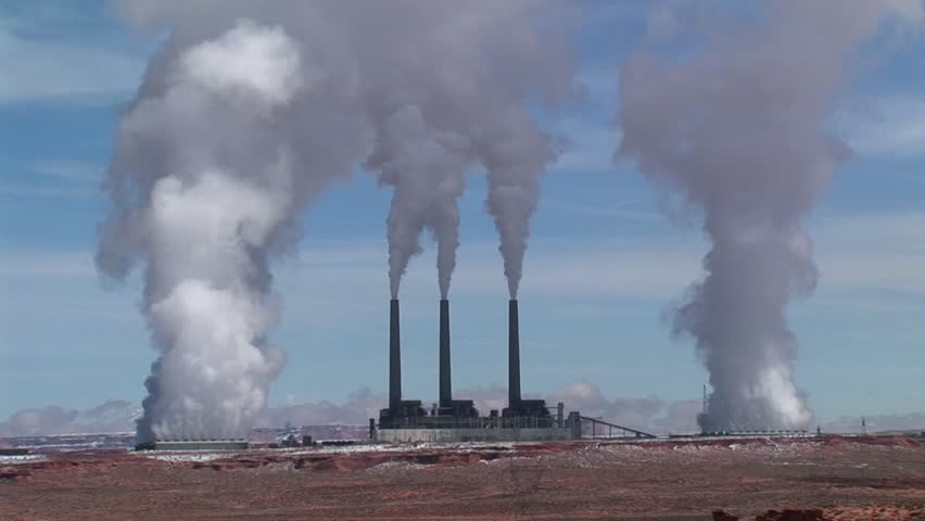Factory in the Arizona desert, belching polluting fumes into the air.